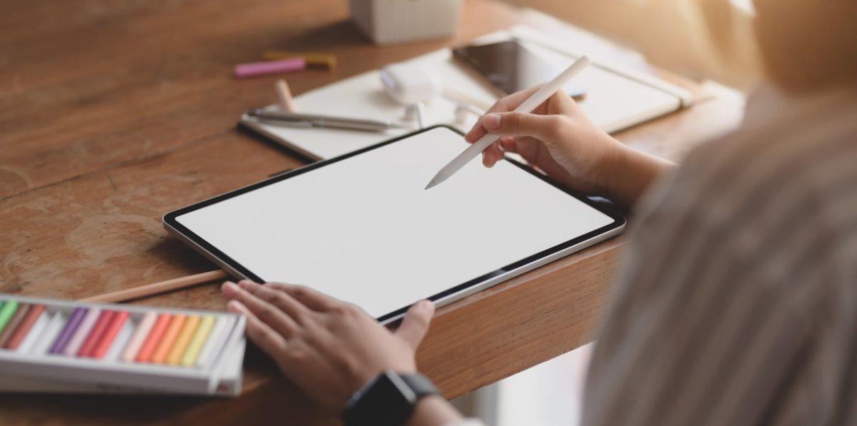 person sketching on digital sketchpad