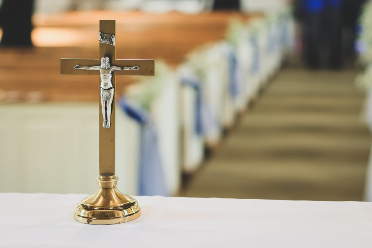 brown and silver cross table decor