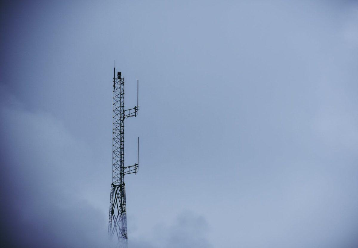 black metal tower under gray sky