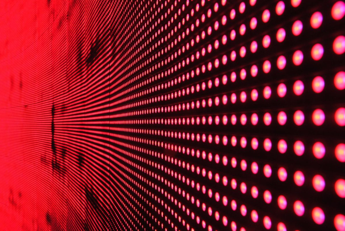 red lights in line on black surface