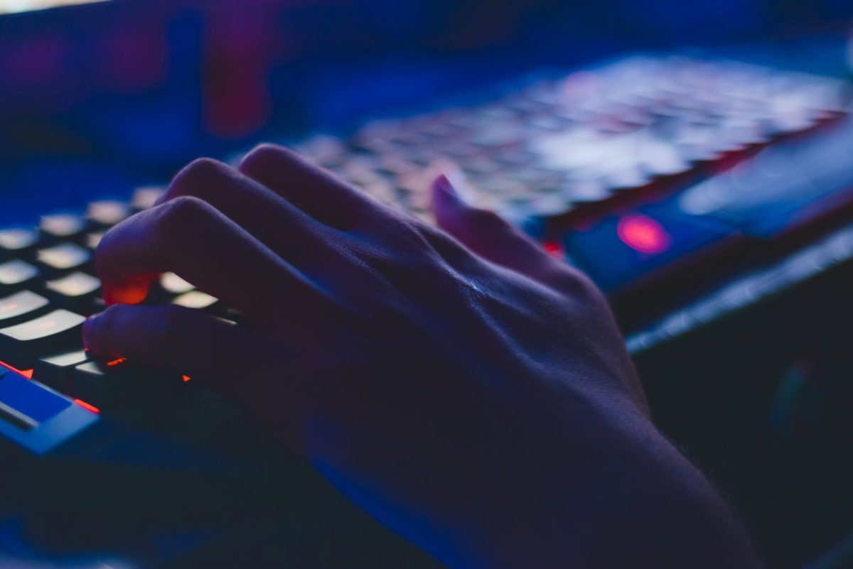 photo of person typing on computer keyboard