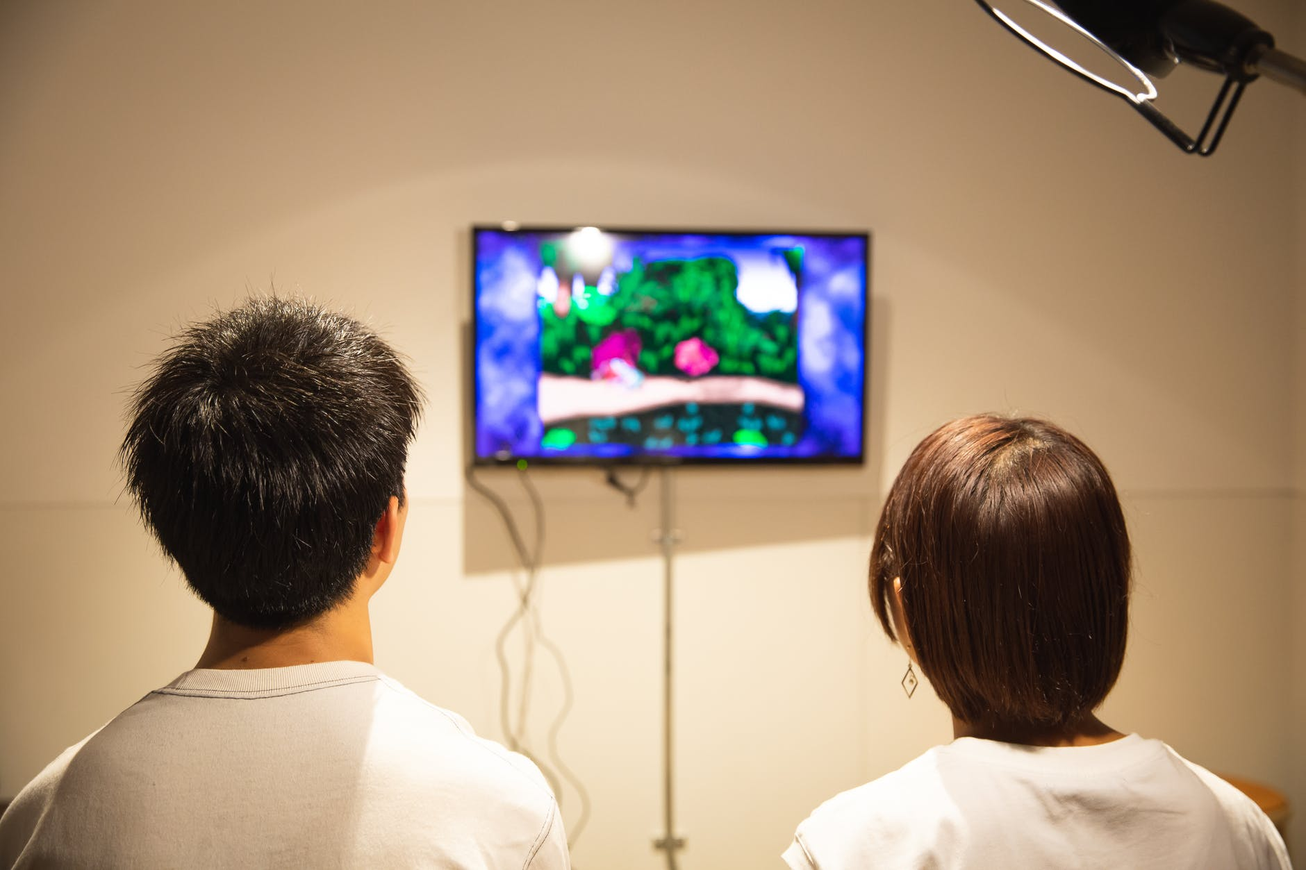 unrecognizable young couple playing video game at home