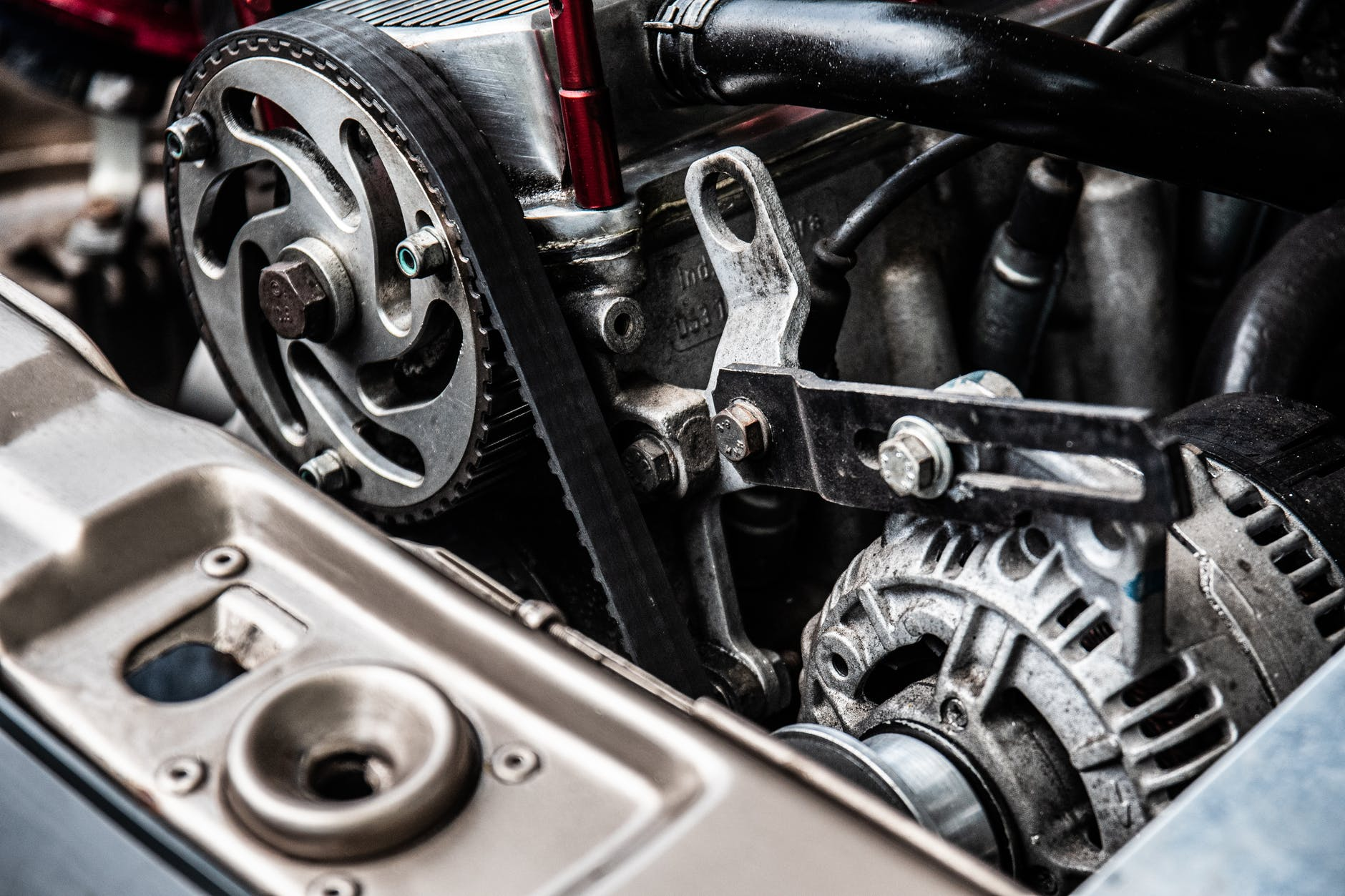 close up photo of black and silver car engine