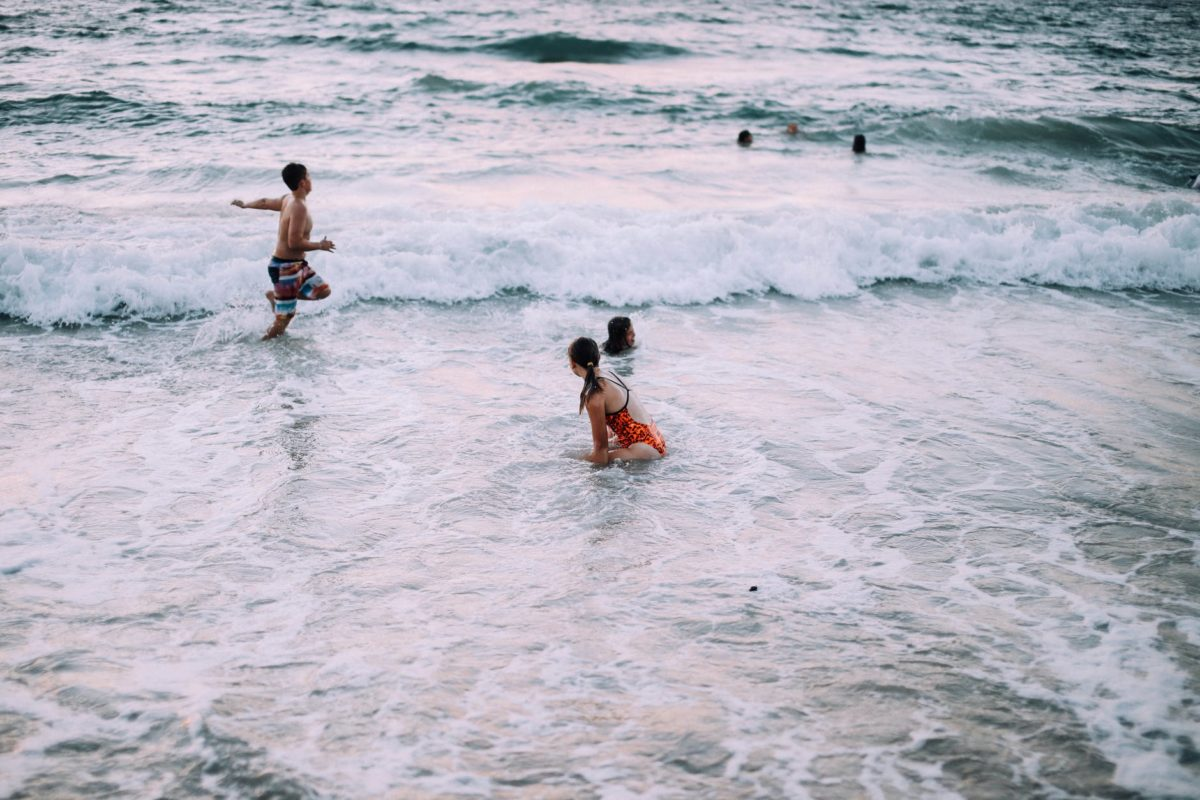 people enjoying vacation in foaming sea