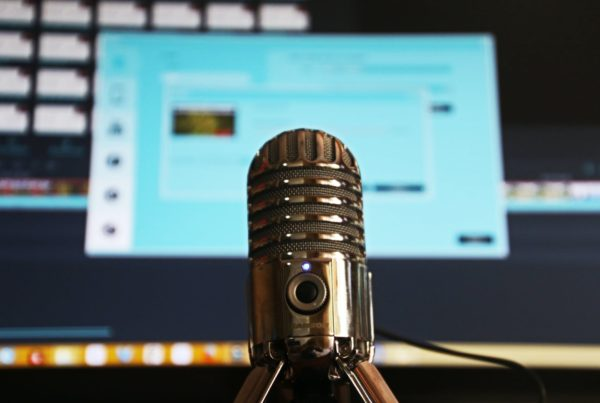 Podcast selective focus photography of gray stainless steel condenser microphone