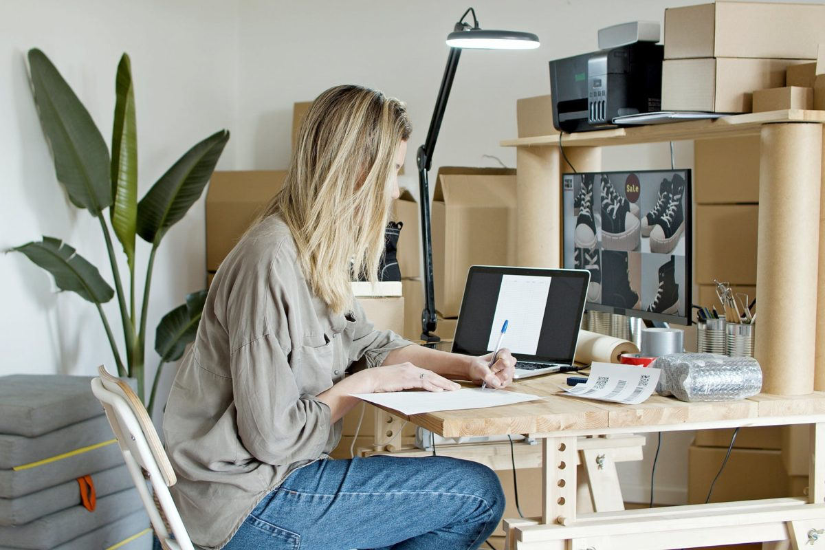 woman busy writing on the paper